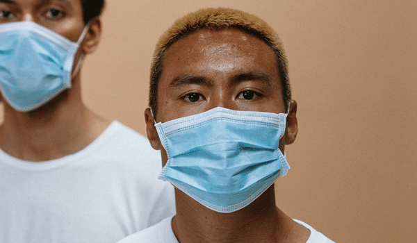 health workers wearing face mask 3957987 - COVID-19: What happens when I talk to my GP?