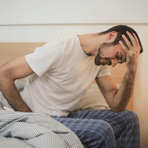 young man in sleepwear suffering from headache in morning 3771115 300x300 - All News